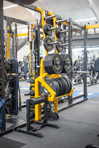 Custom bumper plate storage for University of Michigan football strength
