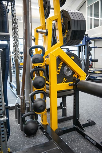 Custom Kettlebell storage on the Dual Rack XL at University of Michigan football weight room
